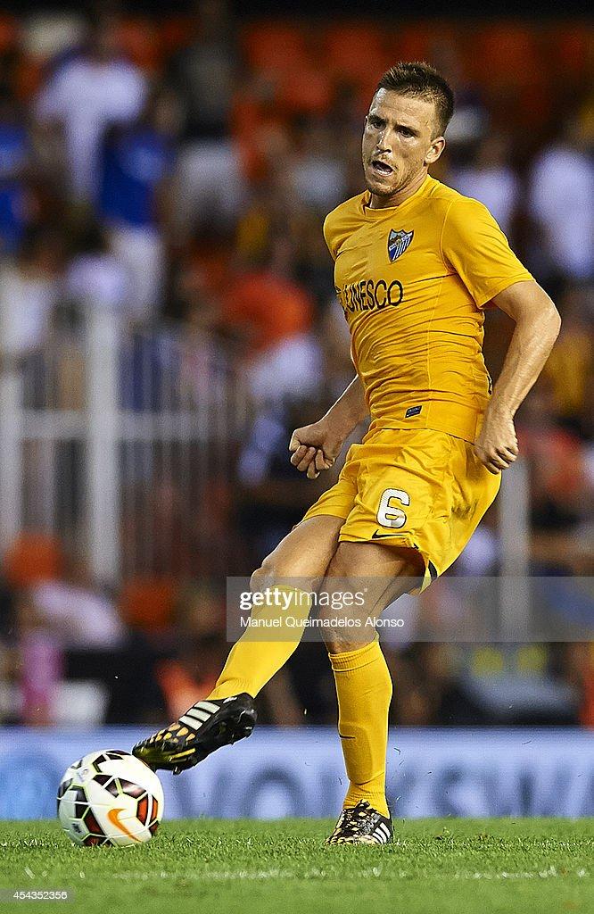 Ignacio Camacho of Malaga in action during the La Liga match between Valencia CF and Malaga CF at Estadi de Mestalla on August 29, 2014 in Valencia, Spain.