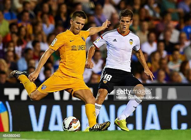 Ignacio Camacho of Malaga is closed down by Bruno Zuculini of Valencia during the La Liga match between Valencia CF and Malaga CF at Estadi de...
