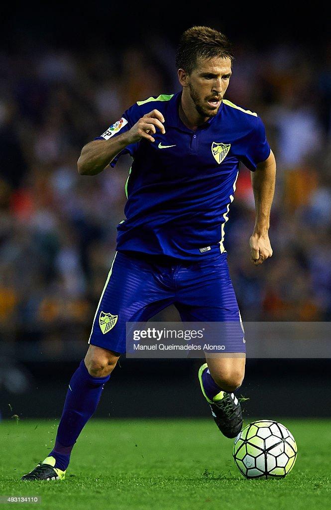 Ignacio Camacho of Malaga runs with the ball during the La Liga match between Valencia CF and Malaga CF at Estadi de Mestalla on October 17, 2015 in Valencia, Spain.