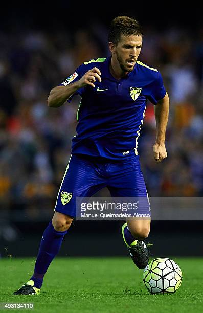 Ignacio Camacho of Malaga runs with the ball during the La Liga match between Valencia CF and Malaga CF at Estadi de Mestalla on October 17 2015 in...