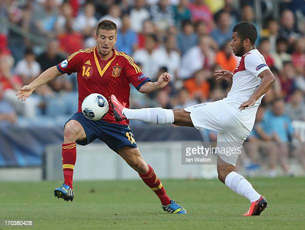 Ignacio Camacho of Spain challenges Tonny Trindade De Vilhena of the Netherlands during the UEFA European U21 Championships Group B match between...