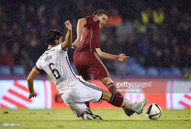 Ignacio Camacho of Spain is challenged by Sami Khedira of Germany during the International Friendly match between Spain and Germany at Estadio...