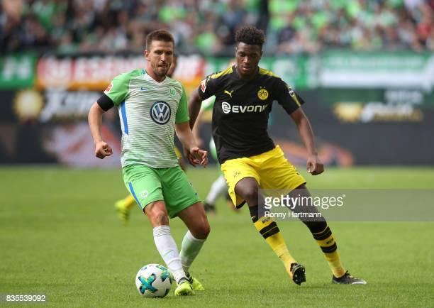 Ignacio Camacho of Wolfsburg and DanAxel Zagadou of Dortmund compete during the Bundesliga match between VfL Wolfsburg and Borussia Dortmund at...