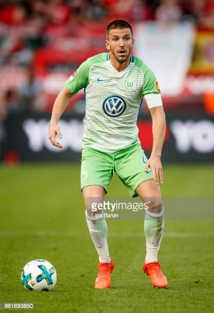 Ignacio Camacho of Wolfsburg runs with the ball during the Bundesliga match between Bayer 04 Leverkusen and VfL Wolfsburg at BayArena on October 15...
