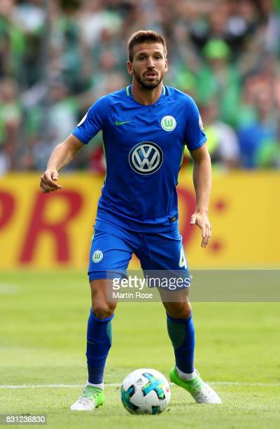 Ignacio Camacho of Wolfsburg runs with the ball during the DFB Cup first round match between FC Eintracht Norderstedt and VfL Wolfsburg at...