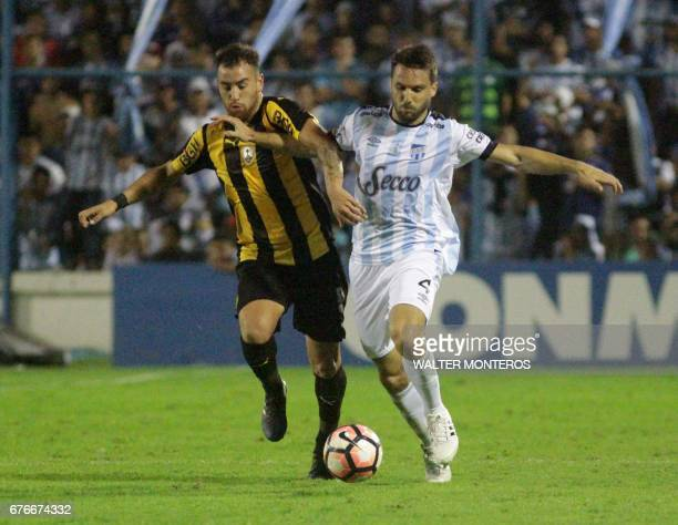 Ignacio Canuto of Argentina's Atletico Tucuman and Junior Arias of Uruguay's Penarol vie for the ball during their Copa Libertadores football match...