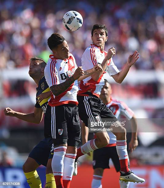 Ignacio Fernandez and Sebastian Driussi of River Plate jumps for a header during a match between River Plate and Boca Juniors as part of Torneo...