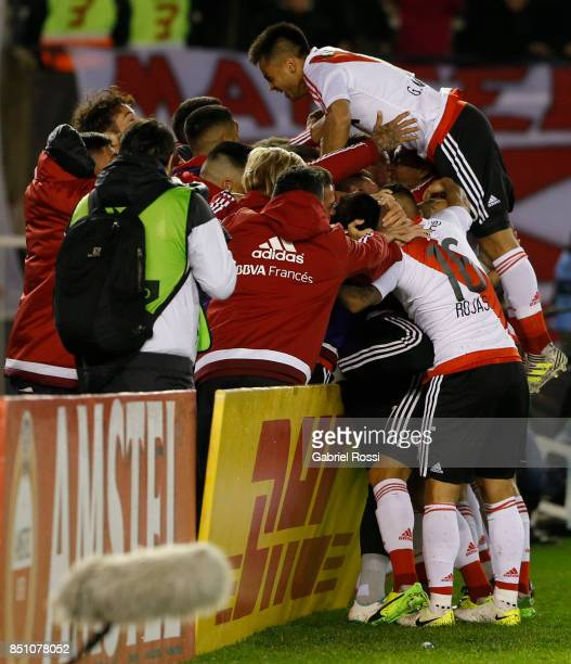 Ignacio Fernandez of River Plate and teammates celebrate their team's sixth goal during a second leg match between River Plate and Wilstermann as...