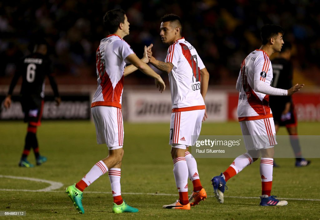 Ignacio Fernandez of River Plate celebrates with Carlos Auzqui after scoring the third goal of his team during a group stage match between FBC Melgar and River Plate as part of Copa CONMEBOL Libertadores Bridgestone 2017 at Monumental de la UNSA Stadium on May 18, 2017 in Arequipa, Peru.