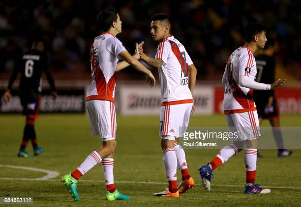 Ignacio Fernandez of River Plate celebrates with Carlos Auzqui after scoring the third goal of his team during a group stage match between FBC Melgar...