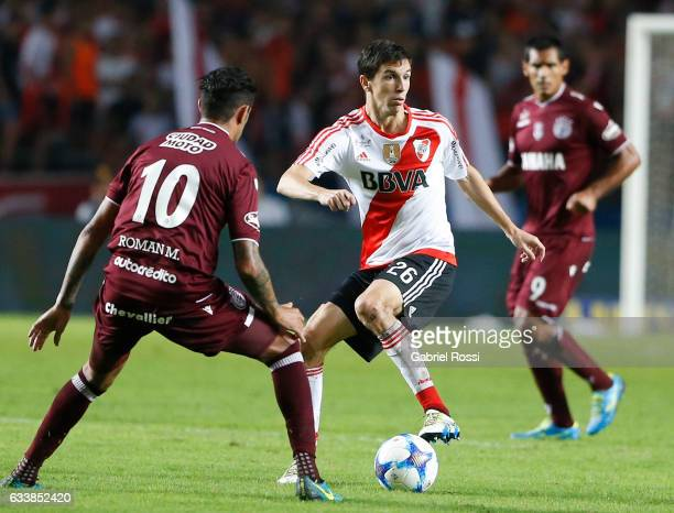 Ignacio Fernandez of River Plate drives the ball against Roman Martinez of Lanus during a match between River Plate and Lanus as part of Supercopa...