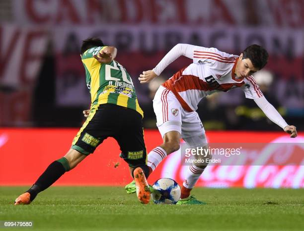 Ignacio Fernandez of River Plate fights for ball with Antonio Medina of Aldosivi during a match between River Plate and Aldosivi as part of Torneo...