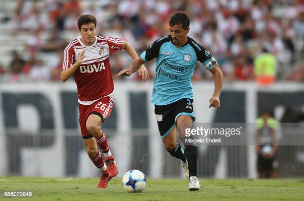 Ignacio Fernandez of River Plate fights for ball with Guillermo Farre of Belgrano during a match between River Plate and Belgrano as part of Torneo...