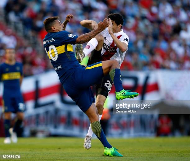 Ignacio Fernandez of River Plate fights for the ball with Edwin Cardona of Boca Juniors during a match between River Plate and Boca Juniors as part...