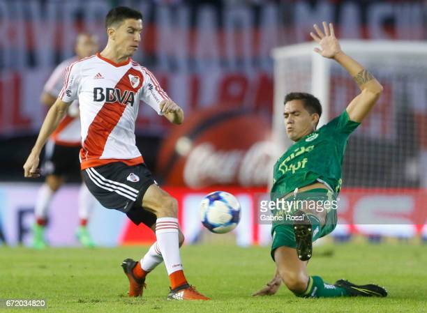 Ignacio Fernandez of River Plate fights for the ball with Francisco Dutari of Sarmiento during a match between River Plate and Sarmiento as part of...