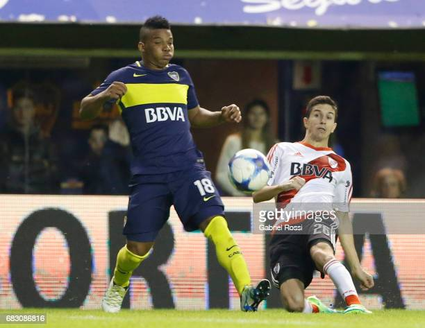 Ignacio Fernandez of River Plate fights for the ball with Frank Fabra of Boca Juniors during a match between Boca Juniors and River Plate as part of...
