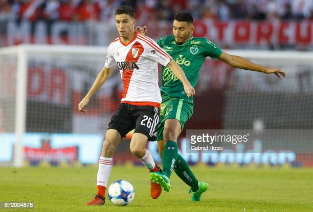 Ignacio Fernandez of River Plate fights for the ball with Gervasio Nuñez of Sarmiento during a match between River Plate and Sarmiento as part of...