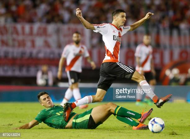 Ignacio Fernandez of River Plate fights for the ball with Gonzalo Di Renzo of Sarmiento during a match between River Plate and Sarmiento as part of...