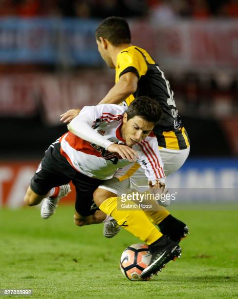 Ignacio Fernandez of River Plate fights for the ball with Luis Alberto Cabral of Guarani during a second leg match between River Plate and Guarani as...