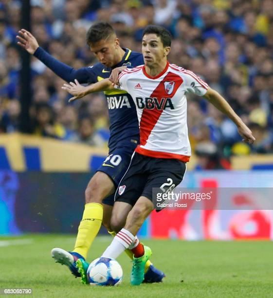 Ignacio Fernandez of River Plate fights for the ball with Rodrigo Bentancur of Boca Juniors during a match between Boca Juniors and River Plate as...