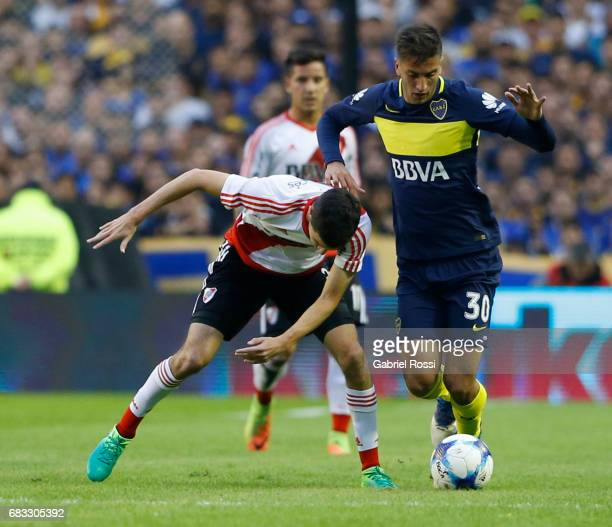 Ignacio Fernandez of River Plate fights for the ball with Rodrigo Bentancur of Boca Juniors during a match between Boca Juniors and River Plate as...