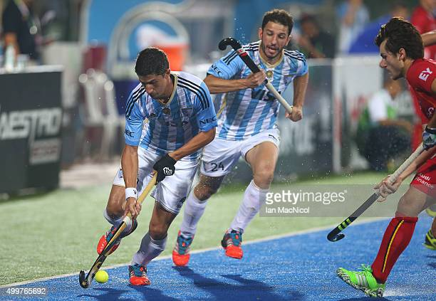Ignacio Oryiz of Argentina runs with the ball during the match between Argentina and Belgium on day seven of The Hero Hockey League World Final at...