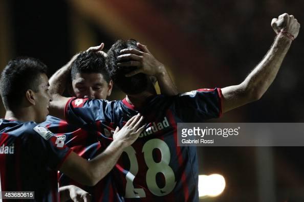 Ignacio Piatti of San Lorenzo and teammates celebrate their team's second goal during a match between San Lorenzo and Botafogo as part of Copa...