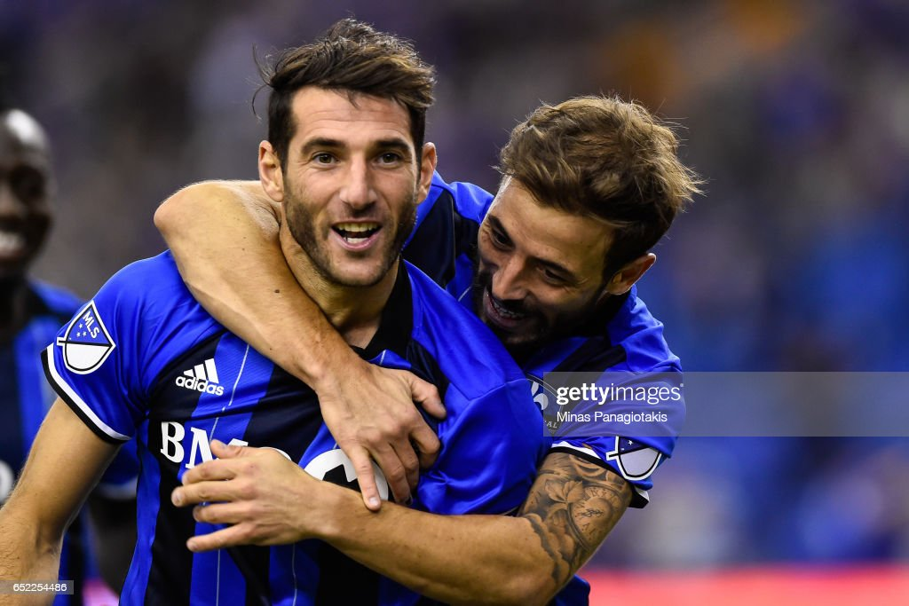 Ignacio Piatti #10 of the Montreal Impact celebrates his goal as teammate Hernan Bernardello #30 gives him a hug during the MLS game at Olympic Stadium on March 11, 2017 in Montreal, Quebec, Canada. The Seattle Sounders FC and the Montreal Impact end up in a 2-2 draw.