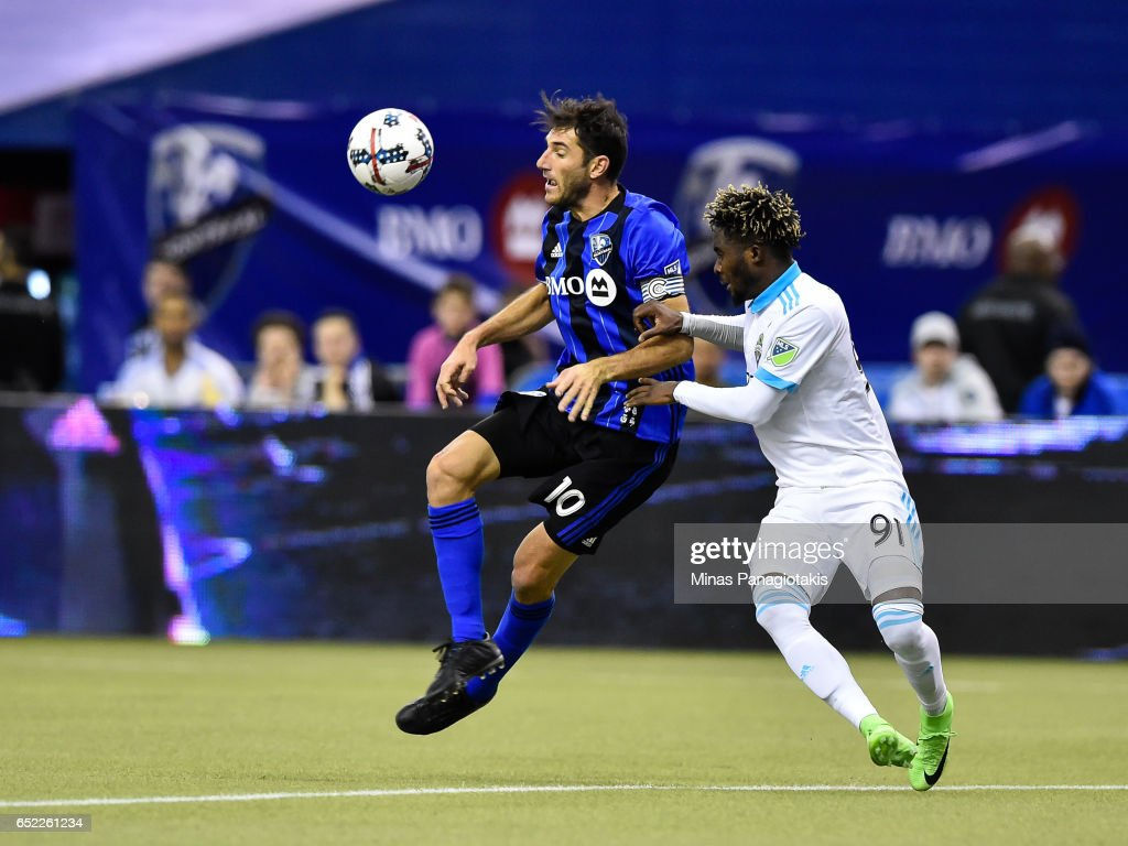 Ignacio Piatti #10 of the Montreal Impact jumps in the air for the ball near Oniel Fisher #91 of the Seattle Sounders during the MLS game at Olympic Stadium on March 11, 2017 in Montreal, Quebec, Canada. The Seattle Sounders FC and the Montreal Impact end up in a 2-2 draw.