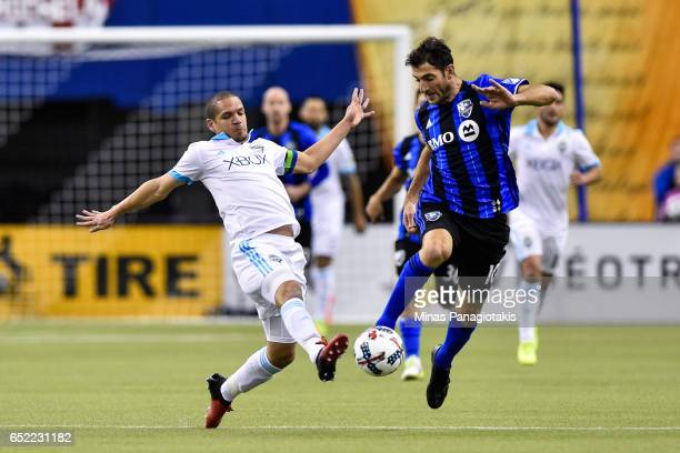 Ignacio Piatti of the Montreal Impact tries to kick the ball past Osvaldo Alonso of the Seattle Sounders during the MLS game at Olympic Stadium on...