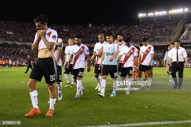 Ignacio Scocco and teammates leave the the field after losing 2 1 against Boca Juniors as part of the Superliga 2017/18 at Monumental Stadium on...