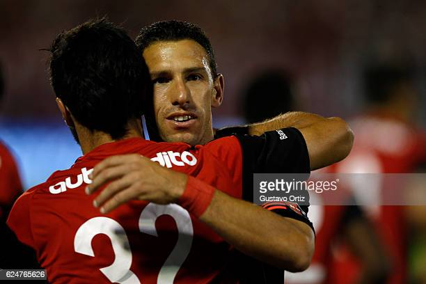 Ignacio Scocco de Newell´s Old Boys celebrates with teammate Maximiliano Rodriguez after scoring the first goal of his team during the match between...