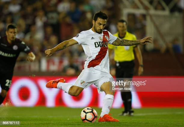 Ignacio Scocco kicks the penalty to score the first goal of his team during a second leg match between Lanus and River Plate as part of the...