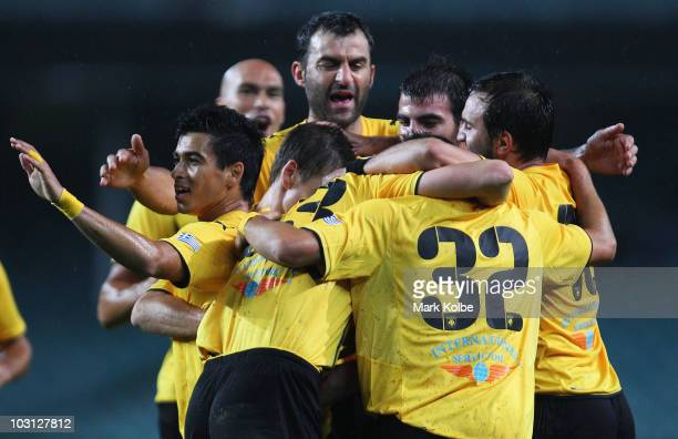 Ignacio Scocco of AEK Athens celebrates with his team after scoring the first goal during the preseason friendly match between AEK Athens FC and...