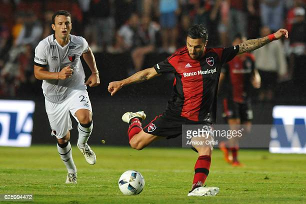 Ignacio Scocco of Newell´s Old Boys and Pablo Ledesma of Colon fight for the ball during a match between Colon and Newell's Old Boys as part of...