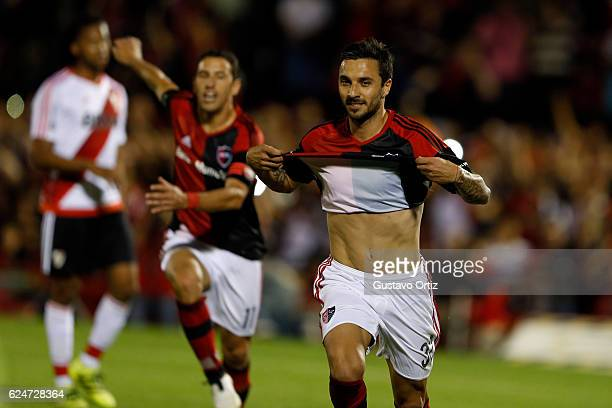 Ignacio Scocco of Newells Old Boys celebrates after scoring the first goal of his team during the match between Newell's Old Boys and River Plate as...