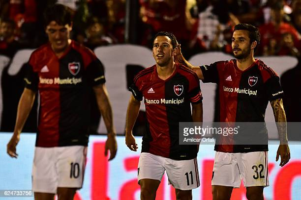 Ignacio Scocco of Newells Old Boys celebrates with teammate Maximiliano Rodriguez after scoring the first goal of his team during the match between...