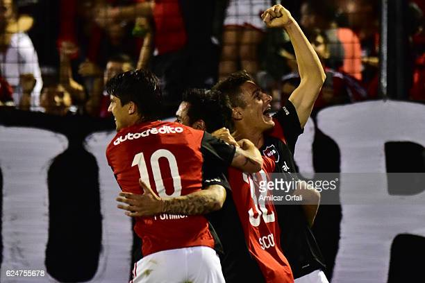 Ignacio Scocco of Newells Old Boys celebrates with teammates Mauro Formica and Sebastian Prediger after scoring the first goal of his team during the...