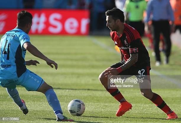Ignacio Scocco of Newell's Old Boys fights for the ball with Alexis Zarate of Temperley during a match between Temperley and Newell's Old Boys as...