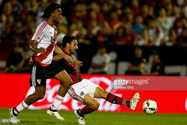 Ignacio Scocco of Newells Old Boys fights for the ball with Arturo Mina of River Plate during the match between Newell's Old Boys and River Plate as...