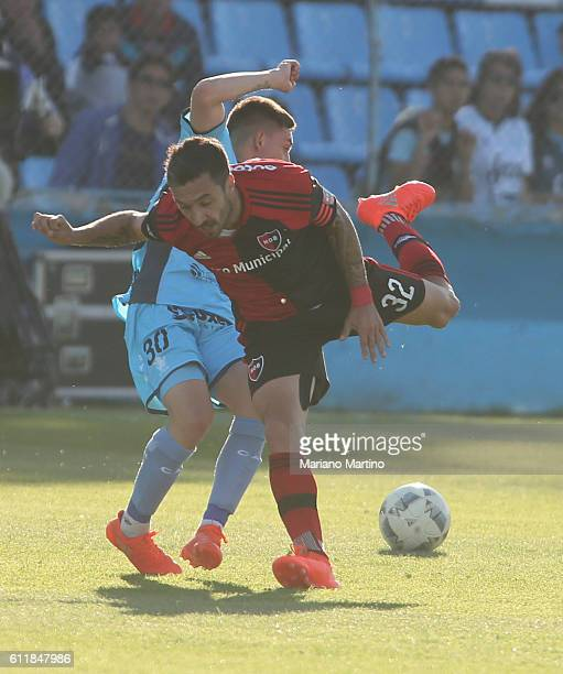 Ignacio Scocco of Newell's Old Boys fights for the ball with Gonzalo Escobar of Temperley during a match between Temperley and Newell's Old Boys as...