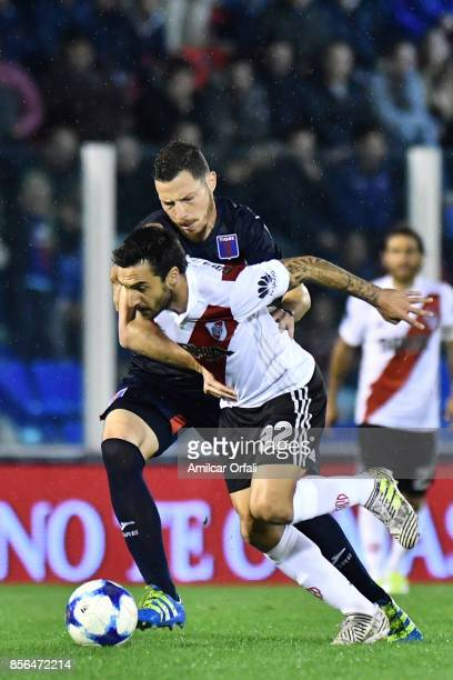 Ignacio Scocco of River Plate and Gaston Bojanich of Tigre fight for the ball during a match between Tigre and River Plate as part of Superliga...