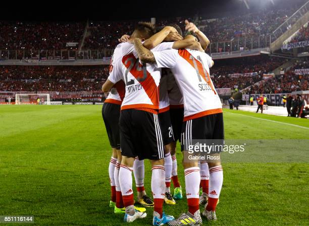Ignacio Scocco of River Plate and teammates celebrate their team's seventh goal during a second leg match between River Plate and Wilstermann as part...