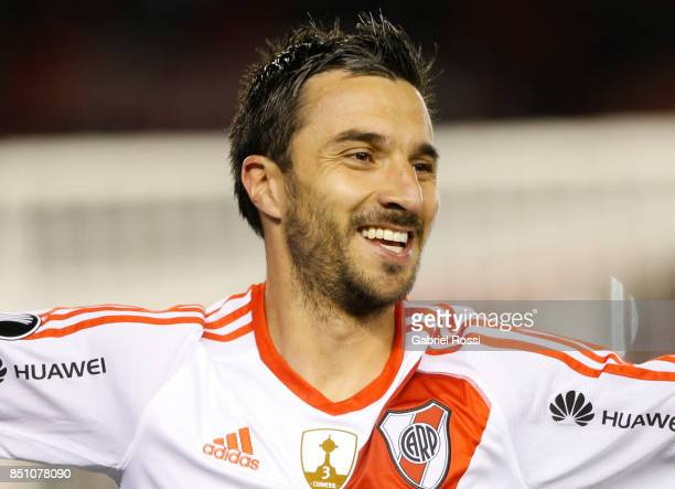 Ignacio Scocco of River Plate celebrates his team's seventh goal during a second leg match between River Plate and Wilstermann as part of the quarter...
