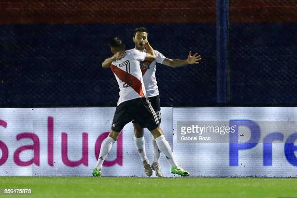 Ignacio Scocco of River Plate celebrates with teammate Carlos Auzqui after scoring the first goal of his team during a match between Tigre and River...