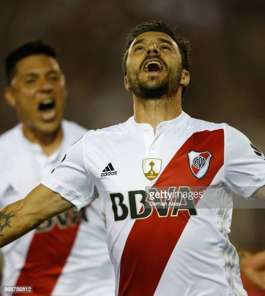 Ignacio Scocco of River Plate celebrates with teammate Enzo Perez after scoring the first goal of his team during a second leg match between Lanus...
