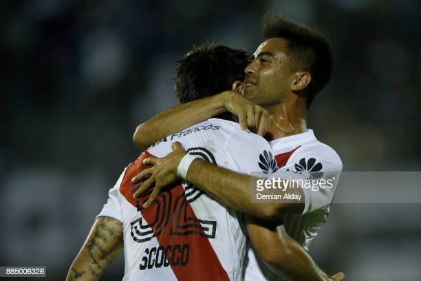 Ignacio Scocco of River Plate celebrates with teammate Gonzalo Martinez after scoring the first goal of his team during a match between Gimnasia y...