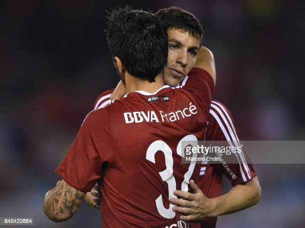 Ignacio Scocco of River Plate celebrates with teammate Ignacio Fernandez after scoring the third goal of his teamduring a match between River Plate...
