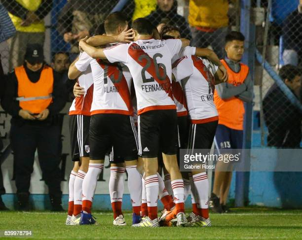 Ignacio Scocco of River Plate celebrates with teammates after scoring the first goal of his team during a match between Temperley and River Plate as...