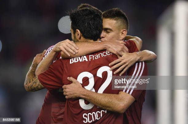 Ignacio Scocco of River Plate celebrates with teammates after scoring the third goal of his team during a match between River Plate and Banfield as...